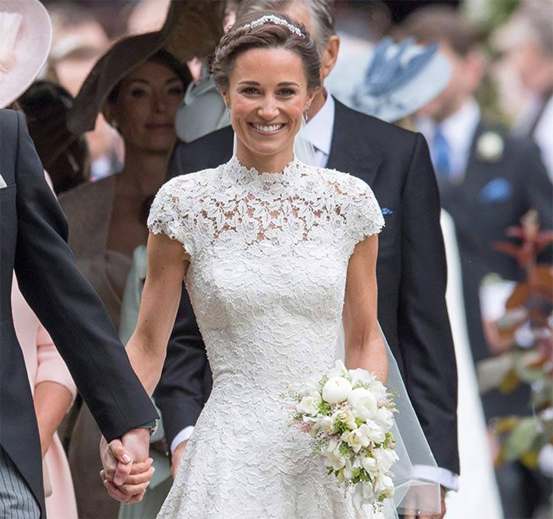 The new Mrs Matthews' dress featured top-to-toe lace, a high neckline and cap sleeves