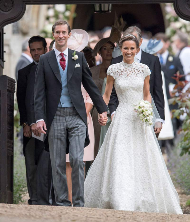 The new Mr. and Mrs. Matthews leaving St. Mark's Church, Englefield, after tying the knot on 20th May.